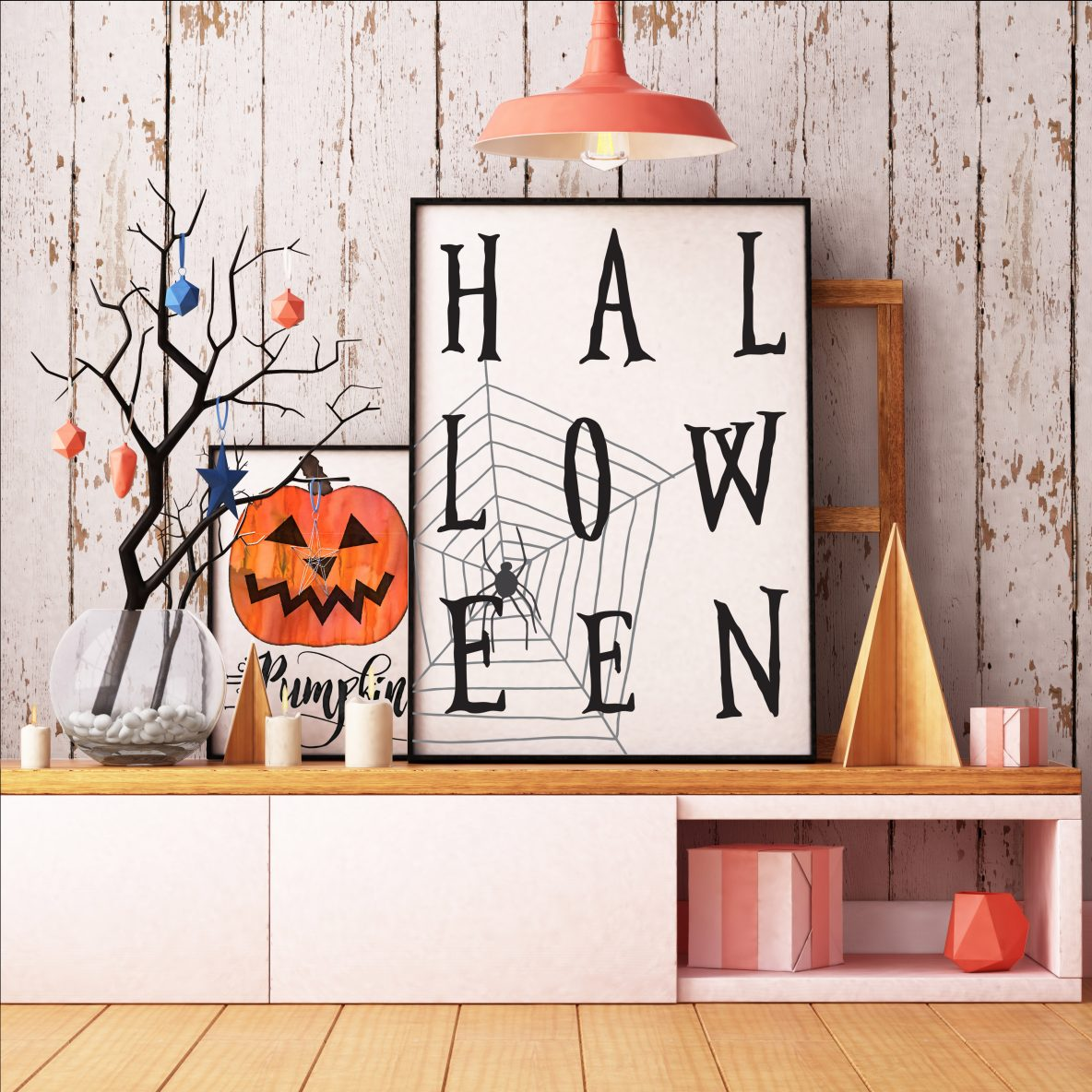 Two Halloween prints with orange and blue decorations around them.